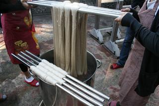 布を織る 経糸染色