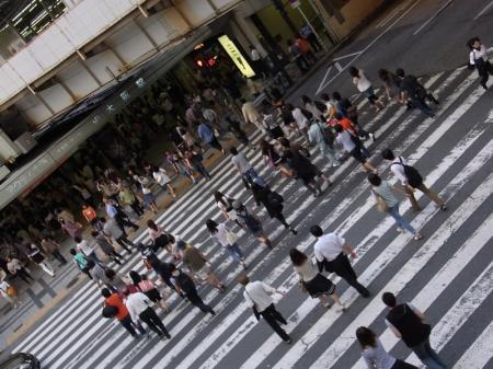 people passing crosswalk