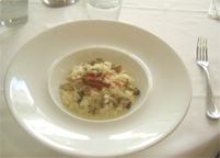 数種茸とグラナパダーノのリゾット ベーコンのクロッカンを添えて